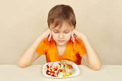 Little boy does not want to eat pasta with cutlet Royalty Free Stock Image