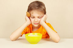 Little boy does not want to eat porridge Royalty Free Stock Photos