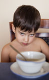 Little boy does not want to eat Stock Image