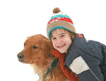 Little Boy with Dog. Boy in Snow Playing with Dog Royalty Free Stock Image