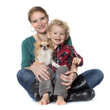 Little boy, dog and mother Royalty Free Stock Image