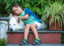 Little boy with a dog Stock Photos