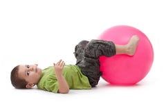 Little boy doing gymnastic exercises Royalty Free Stock Photography