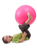 Little boy doing gymnastic exercises Stock Images
