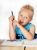 Little boy doing homework Stock Photography