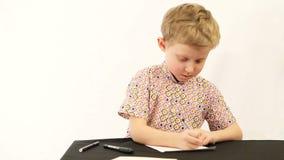 Little boy doing homework stock video