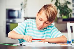 Little boy doing homework Royalty Free Stock Image
