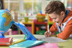 Little boy doing lessons Royalty Free Stock Image