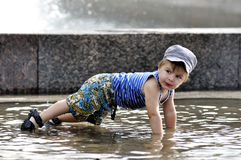 Little boy doing a push-up in water Royalty Free Stock Images