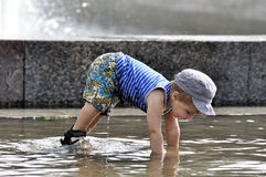 Little boy doing a push-up in water. Little boy doing a push-up stock photography