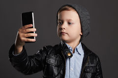 Little boy doing selfie. funny child with a phone. little photographer Stock Photos