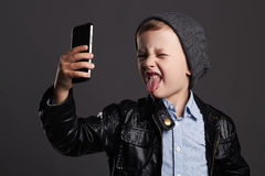Little boy doing selfie. funny child with a phone. little photographer Royalty Free Stock Photos