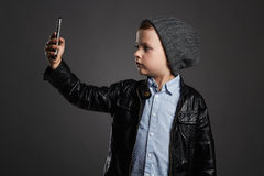 Little boy doing selfie. funny child with a phone. little photographer Royalty Free Stock Photo