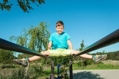 Boy doing sports exercise in park royalty free stock photos