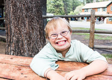 Little Boy With Downs-Syndrome Sitting at Table Stock Photos