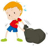 Little boy dragging a black bag Royalty Free Stock Images