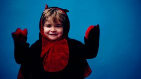 Little boy in dragon costume on a blue background on a Halloween holiday. Halloween party and celebration concept. Little boy in dragon costume on a blue stock video