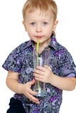 Little boy drank through a straw Stock Photo
