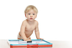 Little boy with draw desk Stock Image