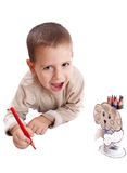 Little boy drawing. Litle boy drawing with red pencil Royalty Free Stock Photography