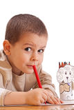 Little boy drawing. With red pencil Stock Photography