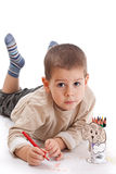 Little boy drawing. With red pencil Stock Photos