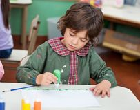 Little Boy Drawing In Art Class Royalty Free Stock Photo
