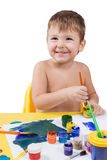 Little boy drawing with a brush Royalty Free Stock Images