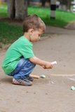 Little boy drawing with chalk Royalty Free Stock Photography