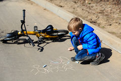Little boy drawing with chalk on asphalt Royalty Free Stock Images