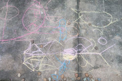Little boy drawing and coloring by chalk on the ground art activity Royalty Free Stock Photos