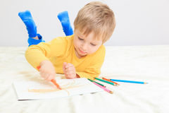 Little boy drawing Stock Photos