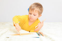 Little boy drawing Royalty Free Stock Image