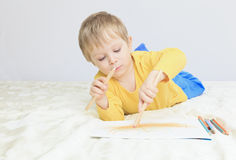 Little boy drawing Royalty Free Stock Photography