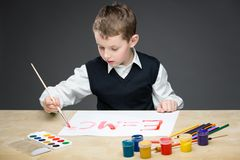 Little boy drawing energy formula Stock Images