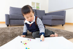 Little boy drawing at home Stock Photo