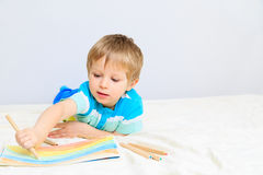 Little boy drawing at home Royalty Free Stock Image