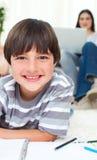 Little boy drawing lying on the floor Stock Photo