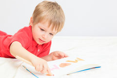 Little boy drawing for mother Royalty Free Stock Images