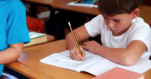 Little boy drawing in notepad in classroom. In elementary school stock video footage