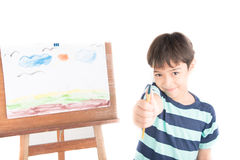 Little boy drawing and painting picture art  in the paper indoor activities Stock Image