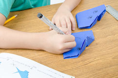 Little boy drawing on paper art origami Stock Photo