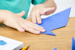 Little boy drawing on paper art origami Royalty Free Stock Image