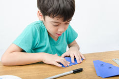 Little boy drawing on paper art origami Royalty Free Stock Photos