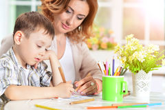 Little boy drawing with pencil. Portrait of cute little boy drawing with pencil Royalty Free Stock Photo