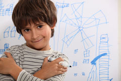 Little boy drawing. A picture stock image