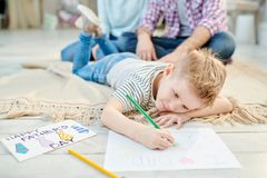 Little Boy Drawing Picture for Fathers Day royalty free stock photography