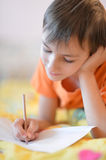 Little boy drawing picture Stock Photo