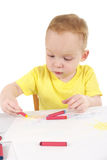 Little boy is drawing the picture Stock Photos