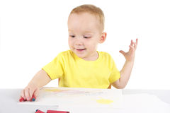 Little boy is drawing the picture Stock Images